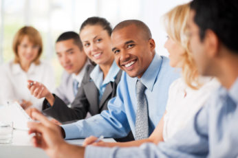 Large group of business people sitting in a row and communicating.  The focus is on African-American looking at the camera.   [url=http://www.istockphoto.com/search/lightbox/9786622][img]http://dl.dropbox.com/u/40117171/business.jpg[/img][/url]  [url=http://www.istockphoto.com/search/lightbox/9786738][img]http://dl.dropbox.com/u/40117171/group.jpg[/img][/url]